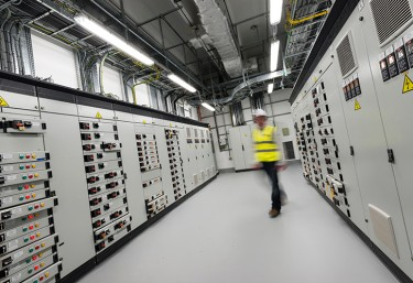 Employee walking through data centre